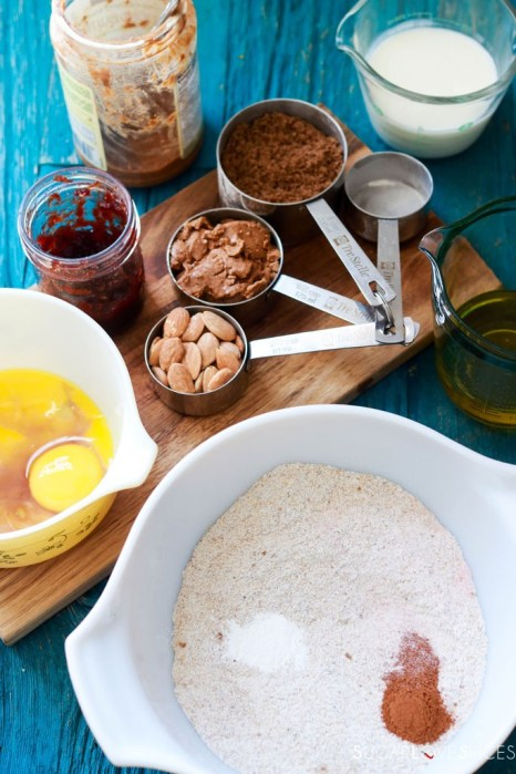 almond butter and jam rye bread-ingredients on the board