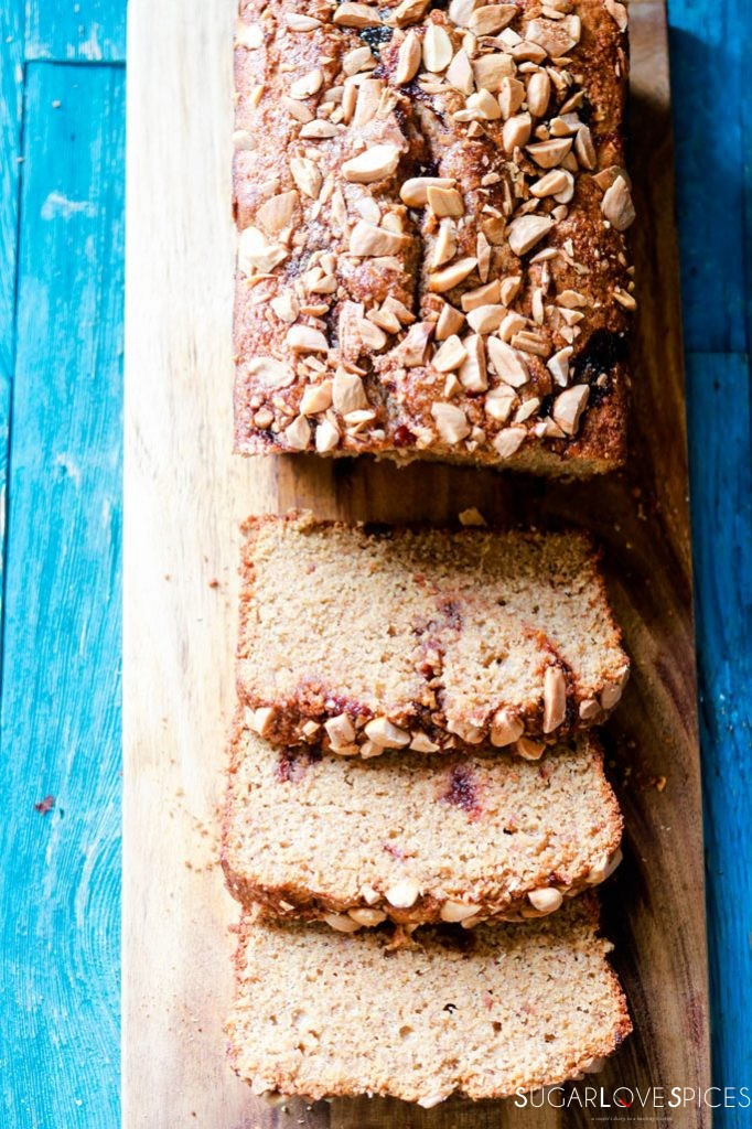 almond butter and jam rye bread-bread sliced on a board