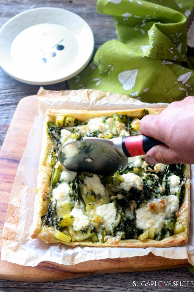 Broccolini and Potato Butter Pastry Tart-cutting the tart with a wheel
