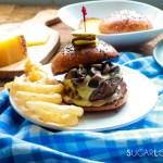 Cheesy Mushroom Lamb Burger-burger in plate with onion rings