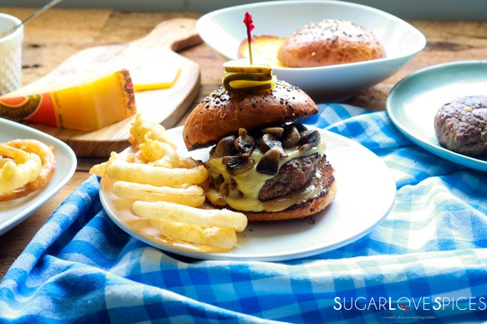 Cheesy Mushroom Lamb Burger-burger in plate with onion rings