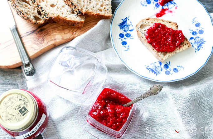 3-Ingredient Easy Raspberry Jam (No Added Pectin)- plate with jam on bread