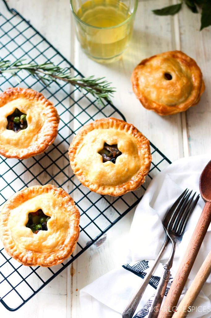 Mini Mushroom Pies with Pea and Potato-on a rack with glass of wine