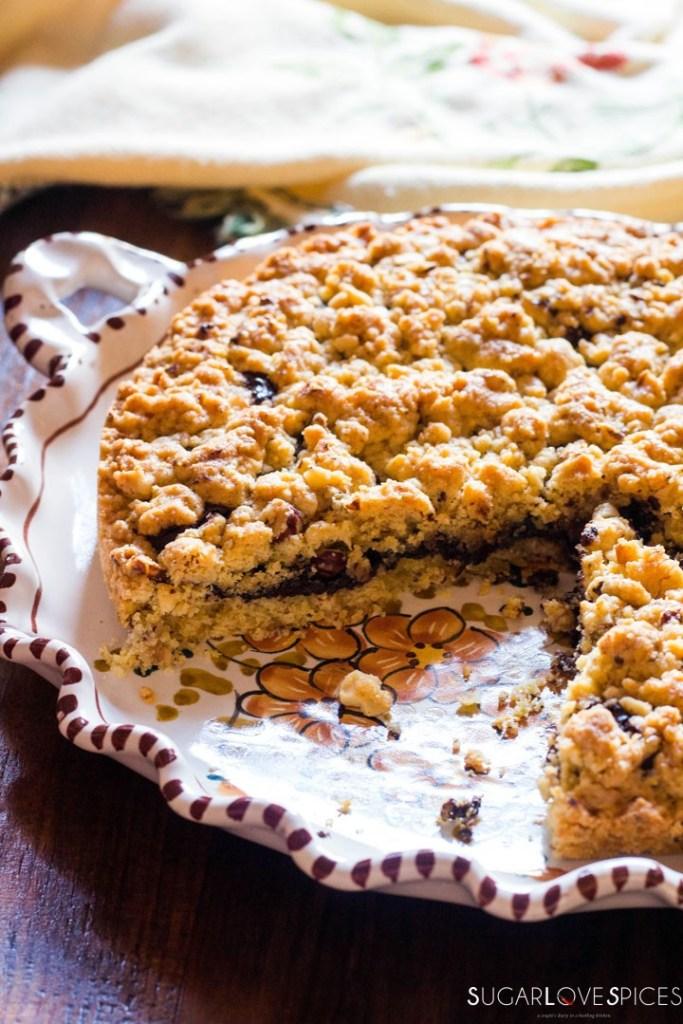 Hazelnut Sbrisolona Cake with Chocolate Spread-in the plate, cut