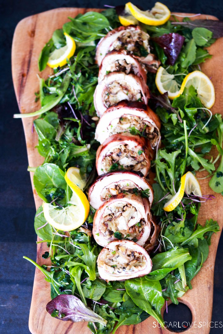 Mushroom Chicken Rolls wrapped in Prosciutto Cotto-slices on woodboard