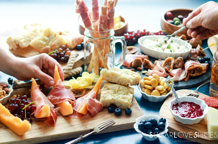 An Antipasto Story featuring Prosciutto-hands on the table