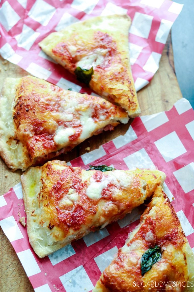 Calzone Napoletano-on paper, cut in wedges