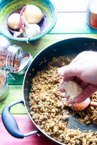Jamaican Beef Patties-beef in the pan-adding breadcrumbs
