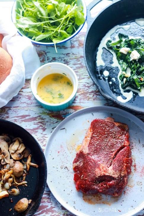 Steak sandwich-uncooked steak and other ingredients around