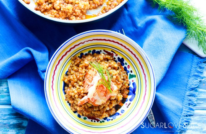 Fregola Sarda with Scampi and Fennel-plated-top view-blue napkin around