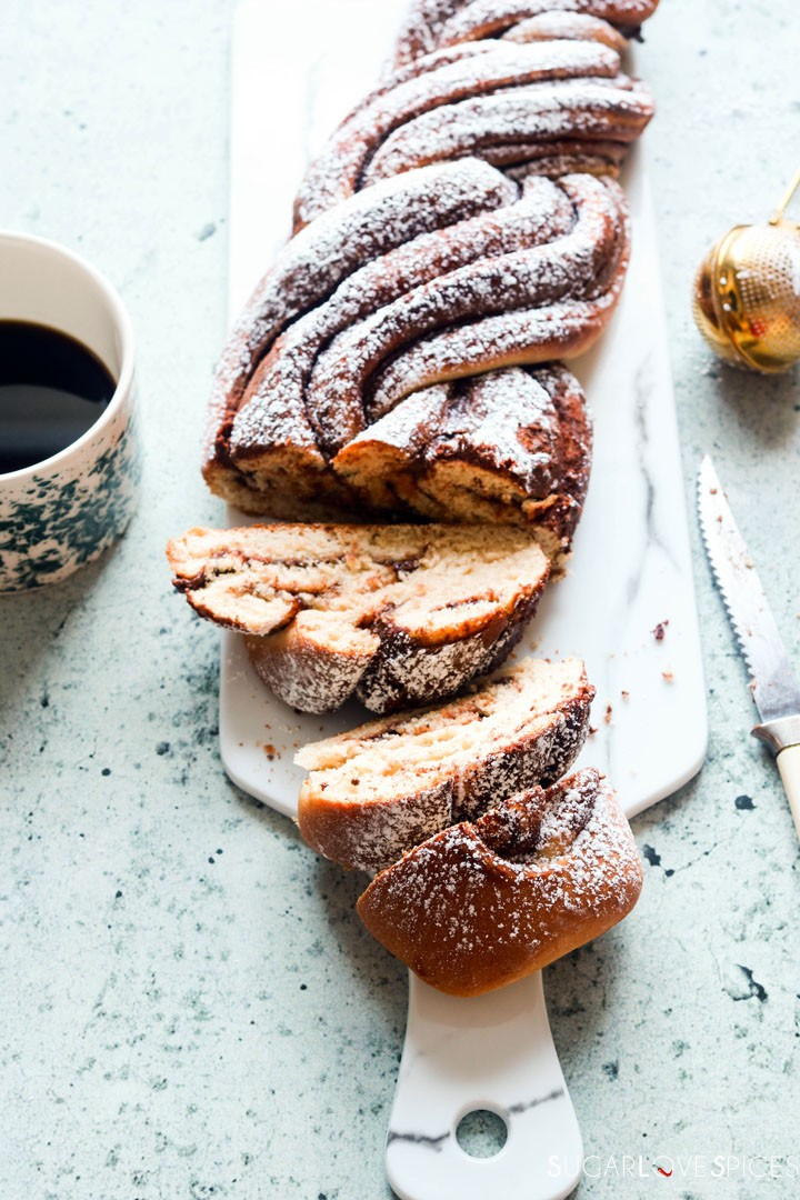 Nutella Pain Brioche Braid-sliced on marbled board-coffee on the side