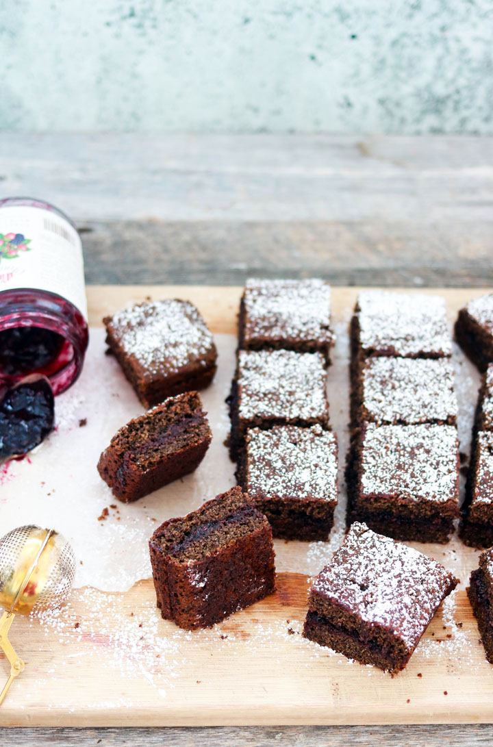 Buckwheat and Jam Cake-squares on a board with jam and spoon