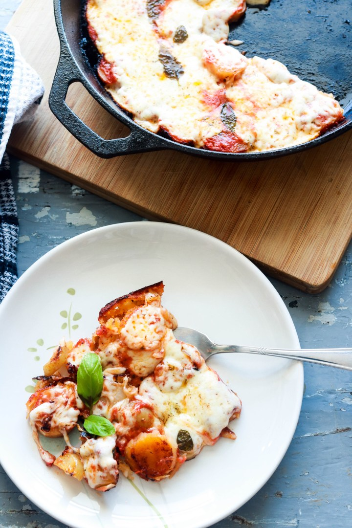 Delicious Skillet Fingerling Potato Parmigiana-plated with fork in