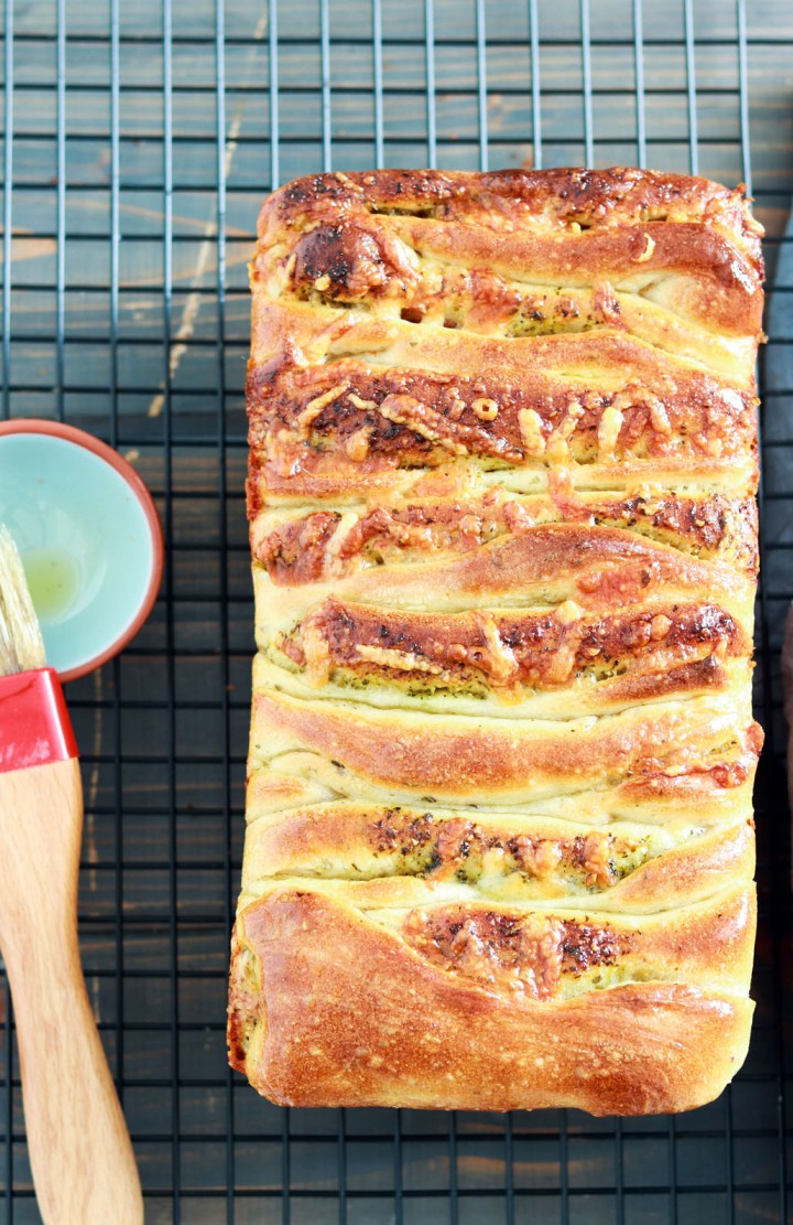 Pesto and Salami Pull-Apart Bread-baked bread on a rack