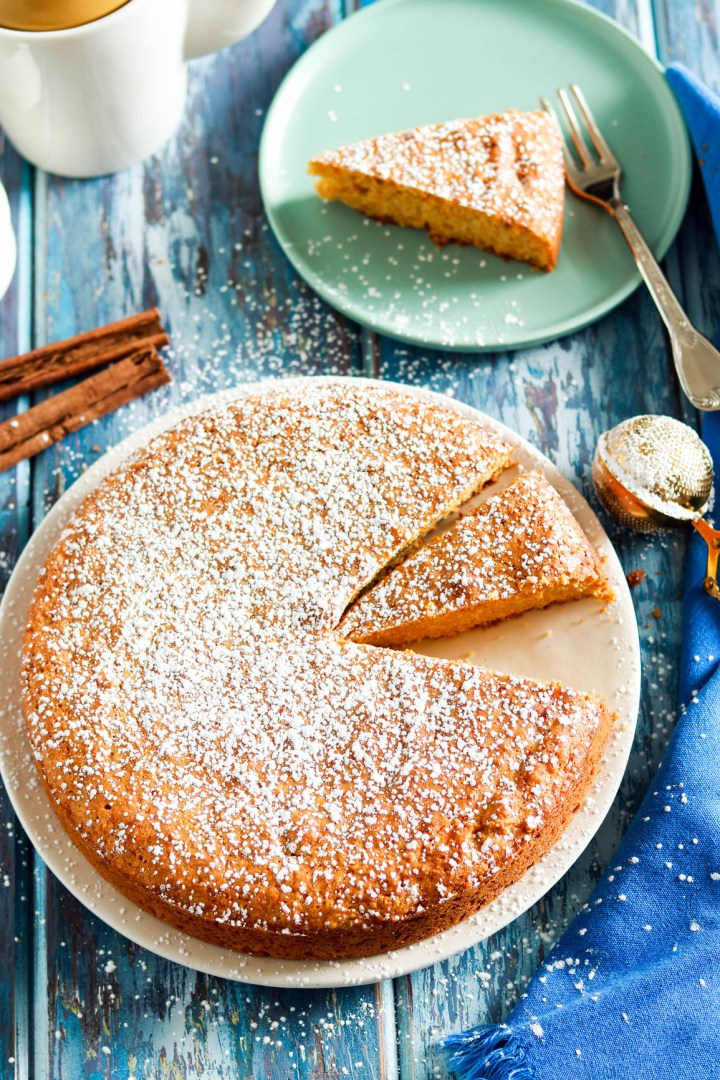 Simple Carrot Almond Cake with Kamut Flour-cake in a plate-slice in background