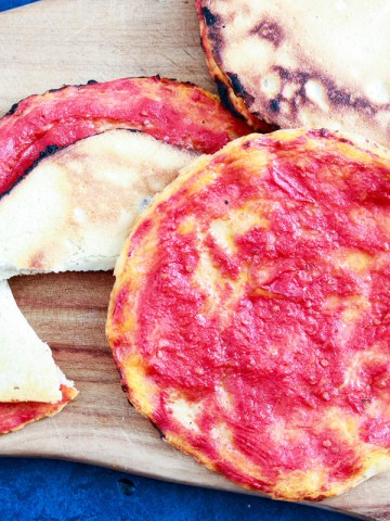 Homemade Pizzette Rosse, a classic Italian snack-feature-four on wood board