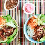 Sweet & sour salmon and Rice bowl with wasabi vinaigrette-two bowls on bamboo mat with ginger