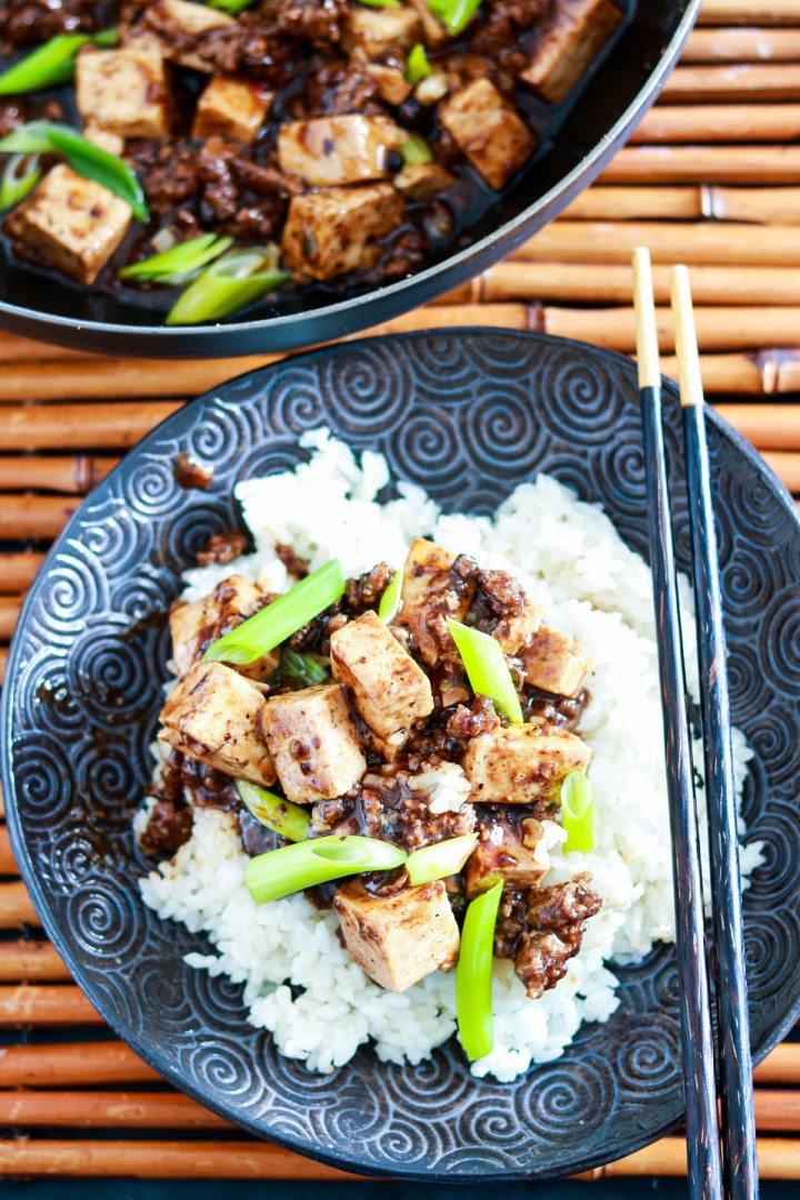 Authentic Sichuan Mapo Tofu Recipe-one plate-pan in background