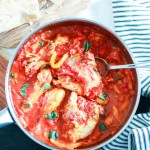 Roman-style Pollo coi Peperoni (Chicken with Peppers and Tomatoes)-feature-in the pan with spoon-bread on the side