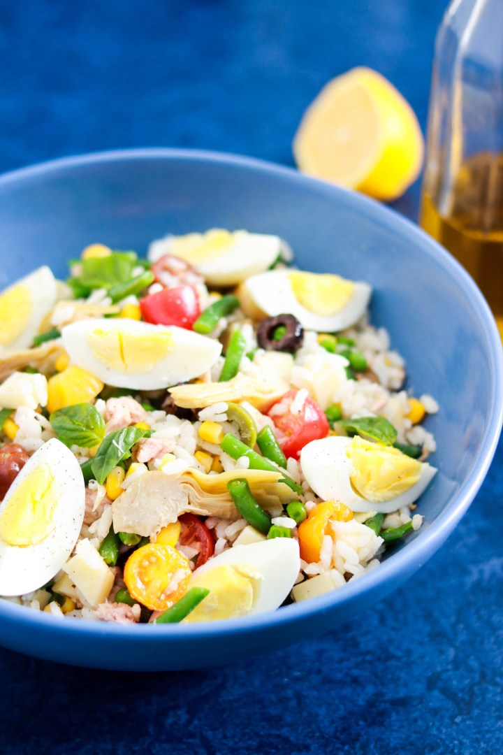Tasty and Easy Italian Insalata di riso with tuna-bowl with oil bottle in background