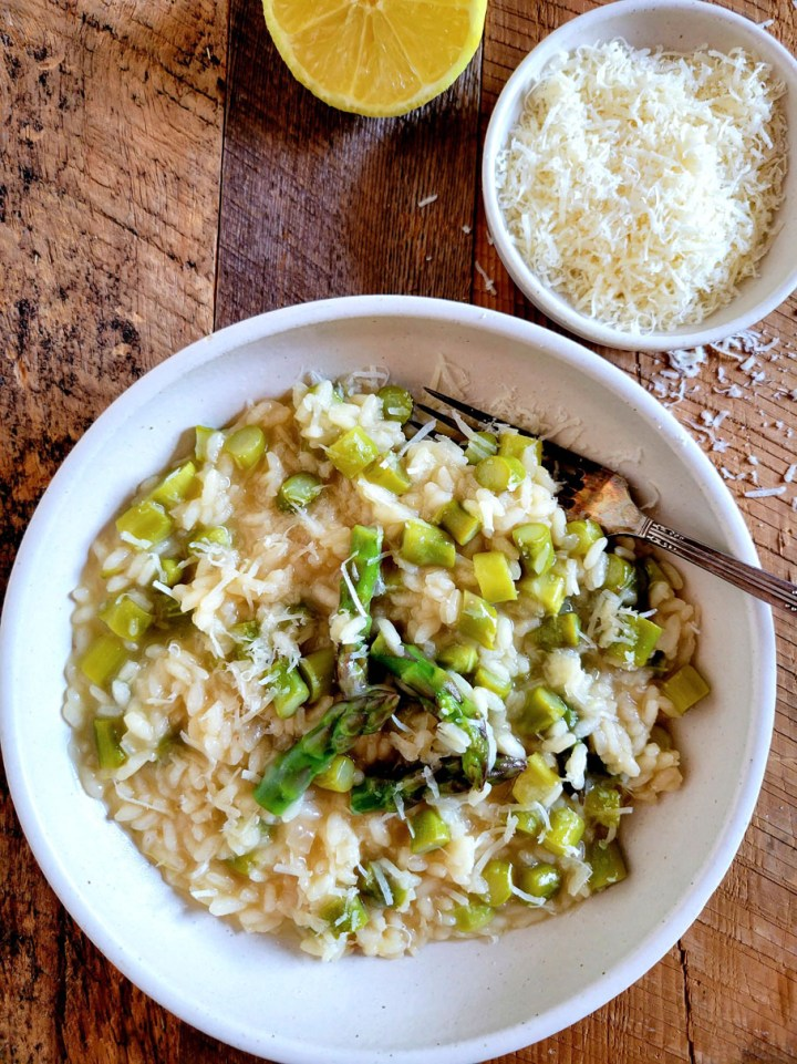 Spring Asparagus Risotto with Lemon-fork in the plate-parmigiano in background