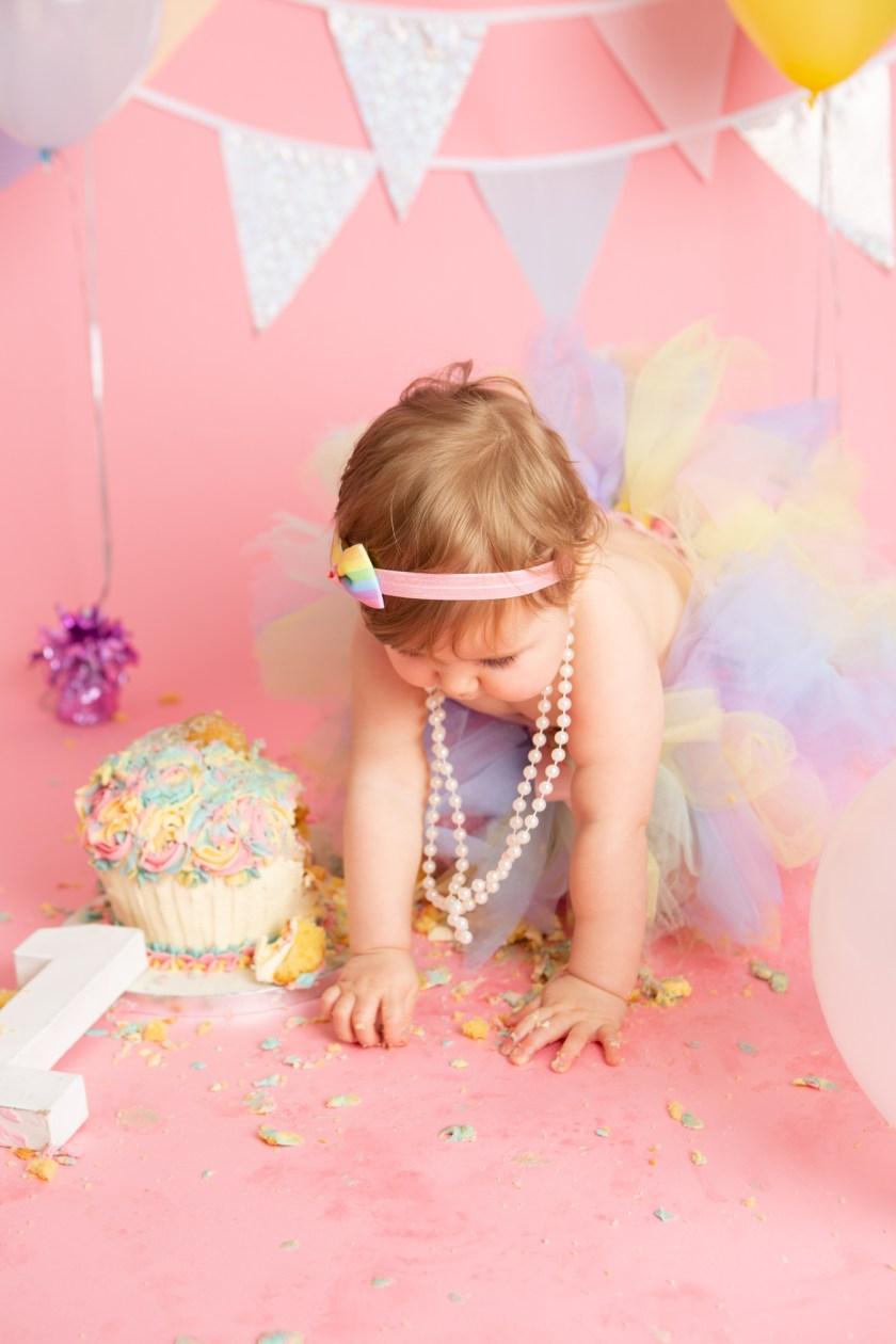 cake smash photography session balloons cake portraits