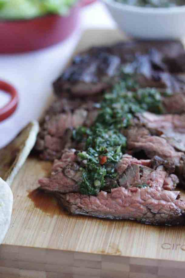 Flank Steak with Chimichurri Sauce. Delicious marinated flank steak with a sharp, herby Chimichurri sauce.