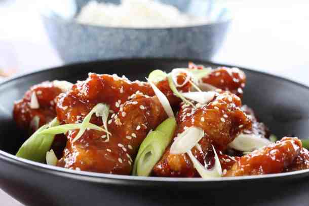 This Crunchy Korean Fried Chicken Wings recipe is a total winner. Affectionately known as KFC, they are fried until crispy, then slathered in a thick, sweet and spicy sauce.