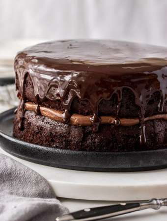 A close up of a two layer chocolate cake