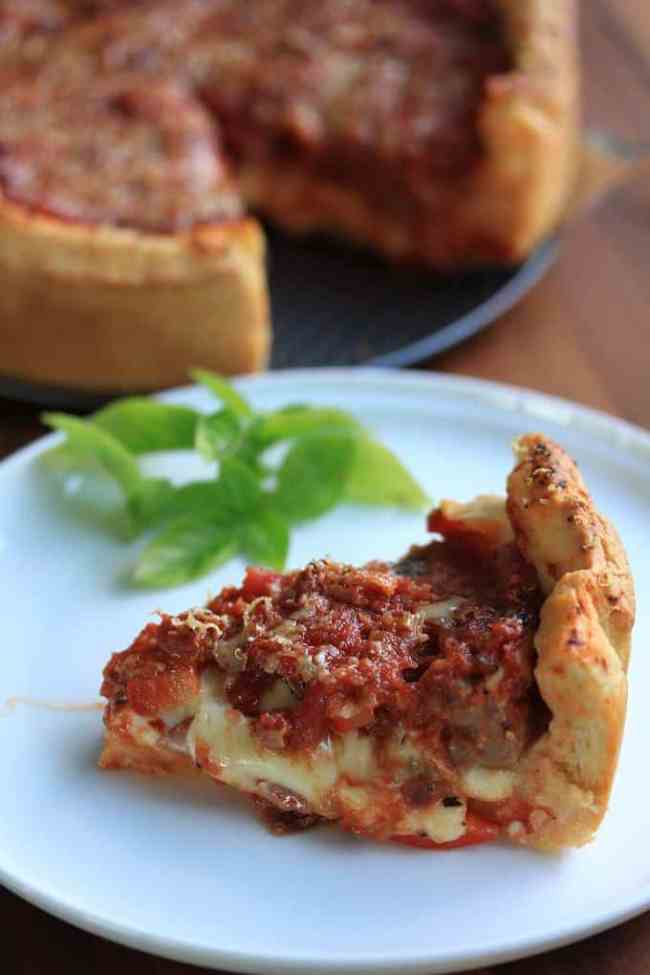Deep Dish Pizza by Sugar Salt Magic - Chicago style Pizza Pie. A thick layer of mozzarella, pepperoni and sausage all topped off with a homemade pizza sauce