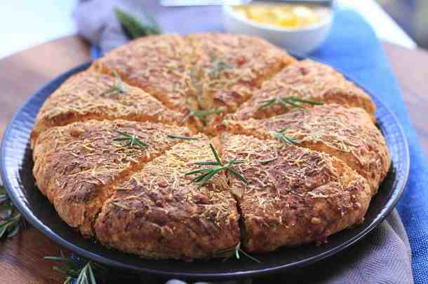 These Cheese and Herb Scones, filled with cheddar and rosemary are a great twist on a classic simple scone recipe. #scones #herbs