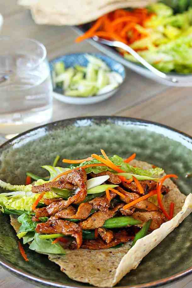 Honey Pepper Pork Wraps by Sugar Salt Magic. Sweet and spicy, but healthy too. And it's so super quick to make, it's perfect after work.