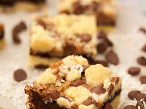 Chocolate Caramel Coconut Bars are shortbread, chocolate brownie, homemade caramel, coconut and choc chips. Yum!