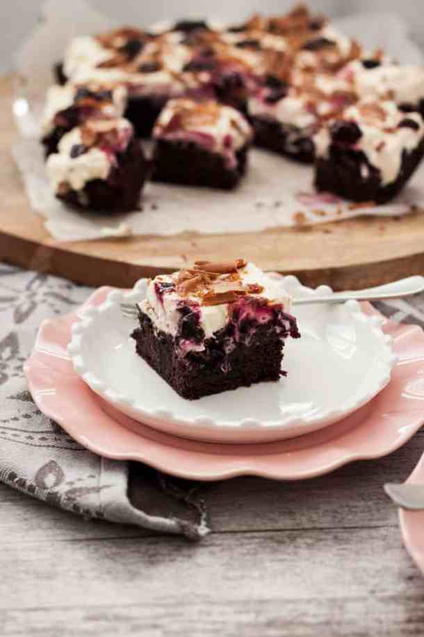 Black Forest Brownies - fudgy chocolate brownies with a layer of real cherries through the centre, whipped cream & homemade cherry jam. #brownies #chocolatebrownies