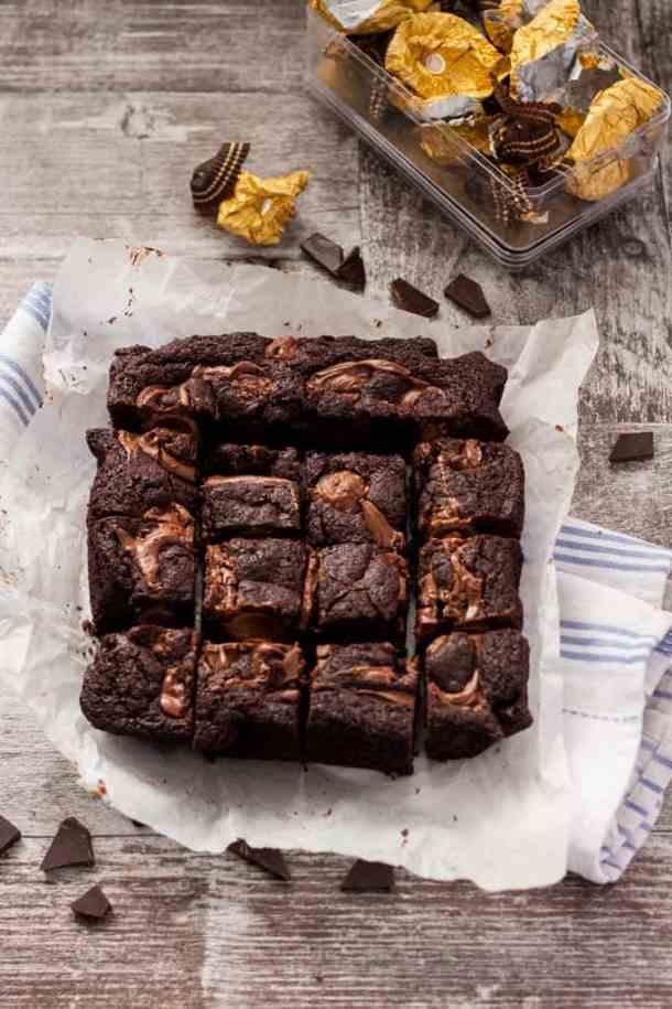 Ferrero Rocher Brownies - Decadent Chocolate Nutella Brownies with a Ferrero Rocher surprise centre #desserts #brownies