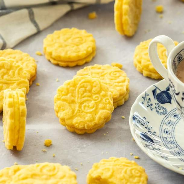 Homemade Custard Creams are delightful sugar cookies filled with a custard flavoured buttercream.