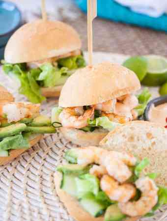 Prawn Sliders with Sriracha Mayonnaise make the perfect party food. Perfect grilled, lightly spiced prawns fill these little rolls, topped with a spicy mayo. #prawnrolls #sliders