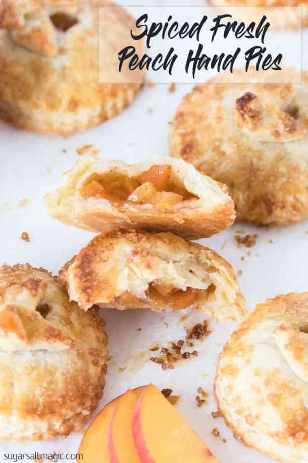 These Spiced Peach Hand Pies are a combination of fresh peaches, a kick of cinnamon and ginger, all wrapped up in the perfect buttery pie crust. These mini pies are the perfect portable dessert. #sugarsaltmagic #handpies #peachrecipes #summerrecipes #piecrust #peachpie