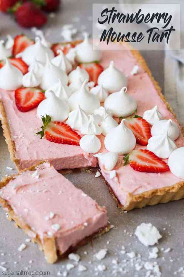 This Strawberry Mousse Tart is a soft silky real strawberry mousse, inside a crisp tart shell and topped with crispy meringue kisses. Such a beautiful Spring dessert. #sugarsaltmagic #strawberrymousse #mousse #strawberrytart #mothersday #springdesserts