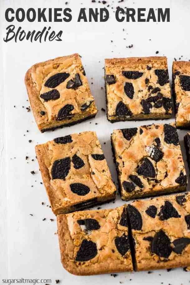 This Cookies and Cream Blondie recipe takes classic blondies to a new level. With a cookie base and filled with cookies and white chocolate, these blondies will disappear before your eyes. #sugarsaltmagic #cookiesandcream #blondies #blondierecipe #easydesserts #brownies