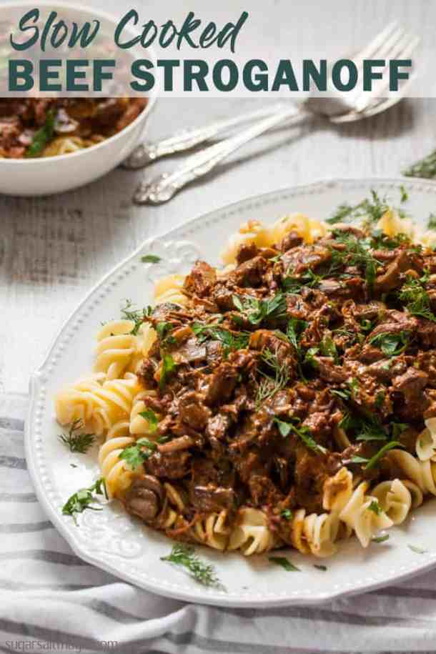 This Slow Cooker Beef Stroganoff recipe is an old classic stroganoff taken to new, melting heights. This is the best beef stroganoff you'll ever taste. #sugarsaltmagic #beefstroganoff #bestbeefstroganoff #beststroganoff #beefstroganoffrecipe #beefstroganoffrecipe #comfortfood #fallrecipes #fallfood #slowcookerrecipes #winterfood #wintermeals