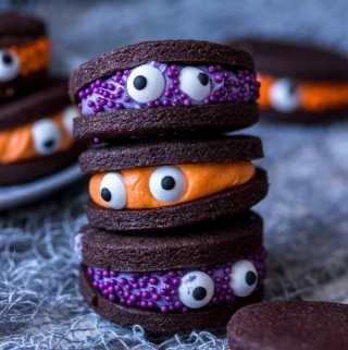 Looking for easy Halloween treats? How about my Chocolate Monster Halloween Cookies? Super cute, fun and easy to make chocolate sandwich cookies with coloured vanilla buttercream filling.