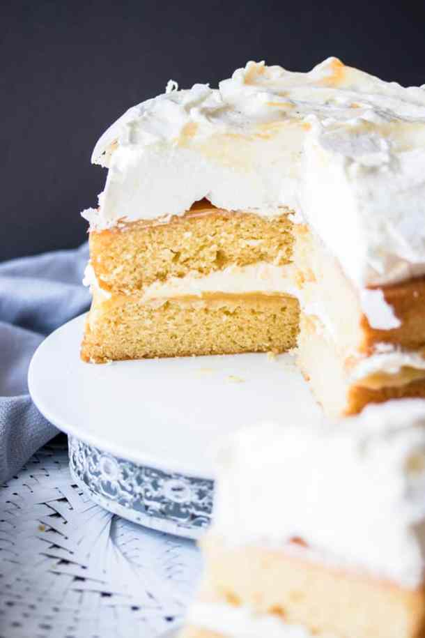 This Lemon Meringue Cake is a simple layered cake, filled with homemade lemon curd and whipped cream and topped with a cloud-like meringue. It makes a dramatic and gorgeous celebration cake.