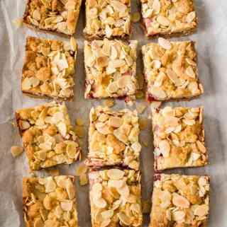 Sweet, chewy, firm and soft all at once Raspberry Almond Shortbread Bars are your new go to easy bake bar. An easy shortbread recipe, some good quality jam and flaked almonds are all you need.