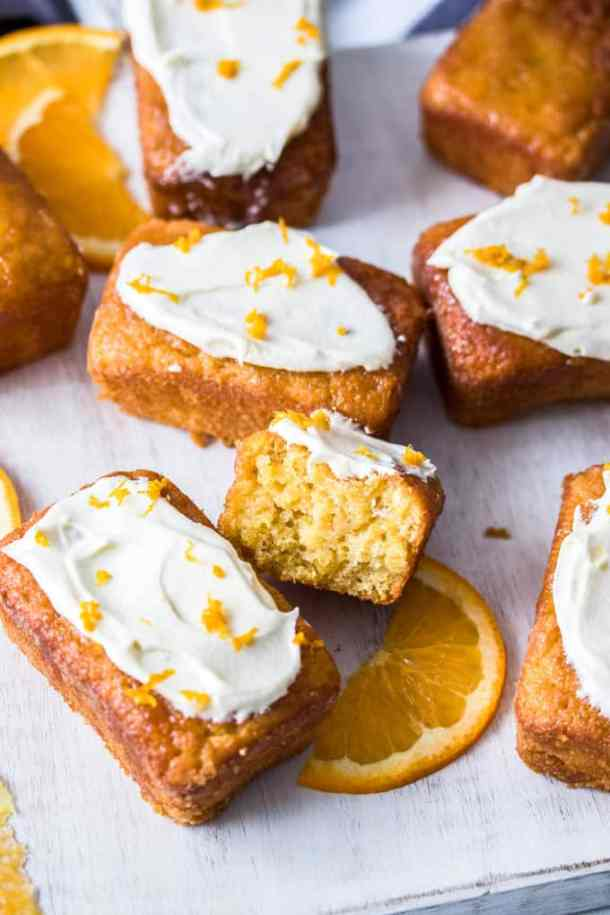 This Mini Flourless Ginger Orange Cake Recipe is bursting with fresh orange flavour and a subtle hint of ginger. They're easy to make, and perfectly portioned individual mini orange cakes.