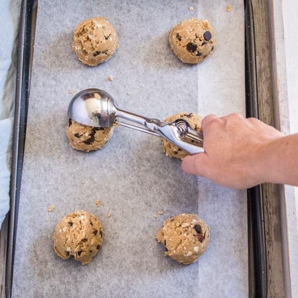 Placing cookie dough onto a baking tray