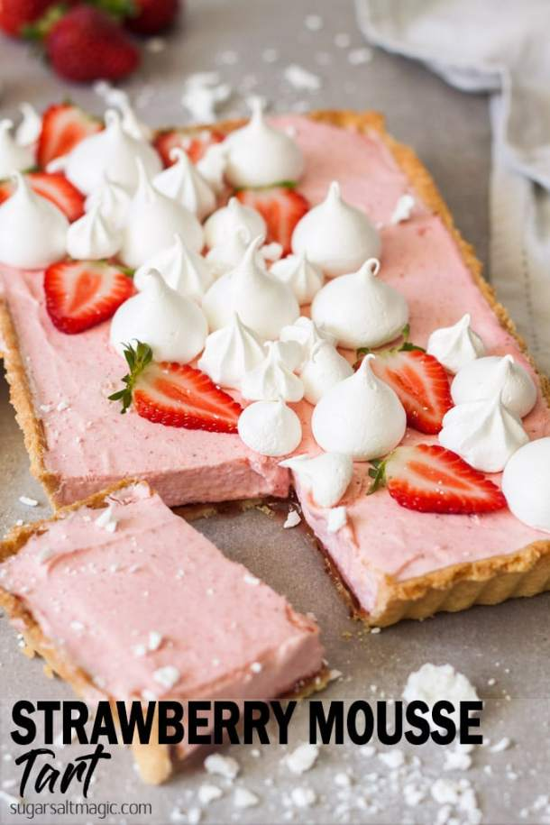 This Strawberry Mousse Tart is a soft silky real strawberry mousse, inside a crisp tart shell and topped with crispy meringue kisses. Such a beautiful Spring dessert. #sugarsaltmagic #strawberrymousse #mousse #strawberrytart