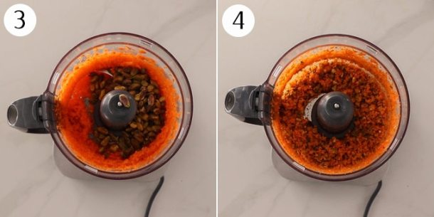 A food processor with finely chopped carrots and pistachios.