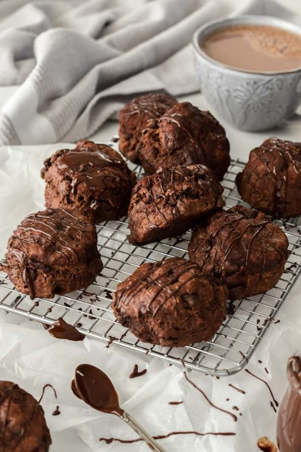 Nine chocolate scones on a wire rack