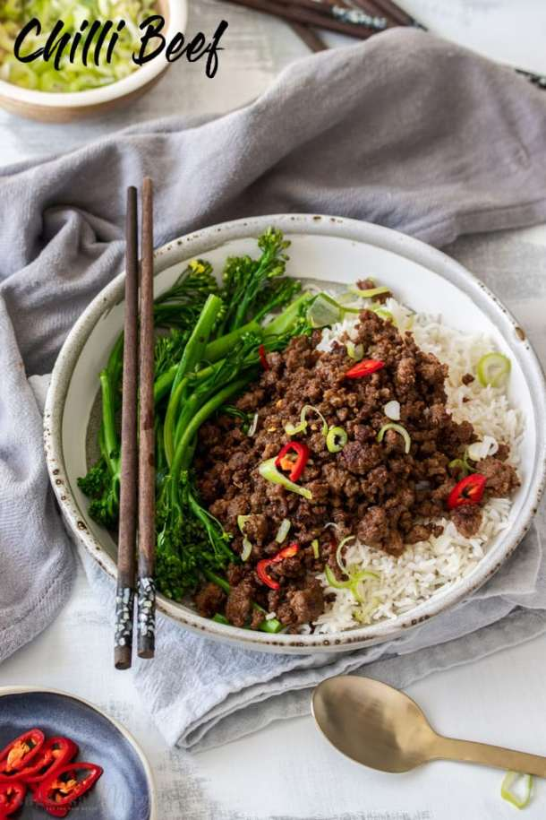 A birdseye view of Chilli Beef Mince in a grey bowl over rice.